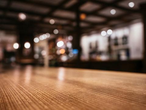 Table top wooden counter Bar restaurant Blur background