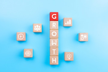 Action plan and Business process management concept, wooden blocks with word GROWTH and business strategy icons on blue background, copy space