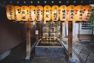 Japanese paper lanterns hanging on water ablution pavilion at Nishiki Tenmangu Shrine, Kyoto, Japan