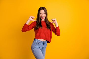 Photo of cute nice charming fascinating gorgeous beautiful youngster adverting herself wearing jeans denim pointing at herself with thumbs isolated vivid color yellow background