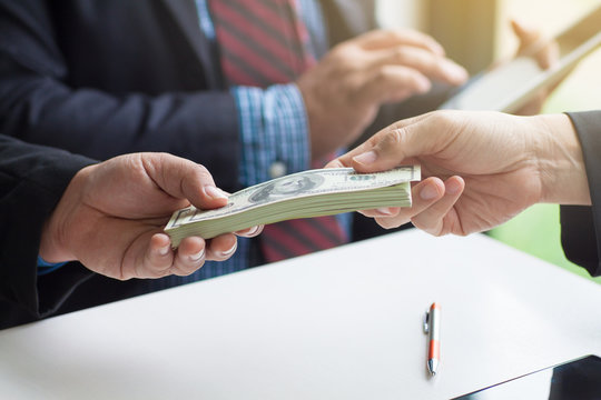 Businessmen give money to businessmen. Business people get money from business people. Businessmen pay the deposit after the contract has been completed.