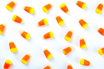 In de dag Draw Bunch of candy corn sweets as sybol of Halloween hoiday on textured background with a lot of copy space for text. Flat lay composition for all hallows eve. Top view shot.
