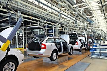 Assembling cars on conveyor line