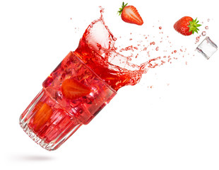 Wall Mural - strawberry and ice cube spilling out of a flying cocktail isolated on white