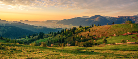 Foto op Plexiglas Landschap Beautiful landscape mountain hill meadow sunrise morning village Bucovina Romania
