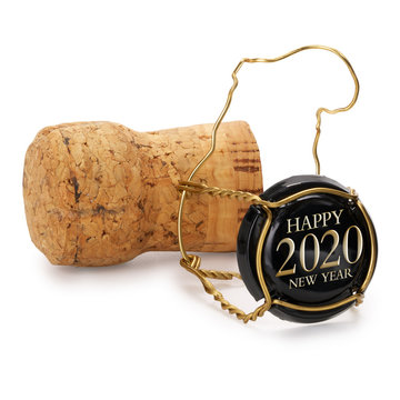 Champagne cork isolated, 2020 on black cap, includes clipping path.