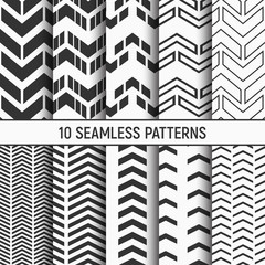 Set of ten seamless patterns of arrows. Abstract geometrical trendy vector monochrome backgrounds.