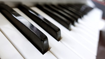 Piano, keyboard piano, side view of instrument musical tool. Background.