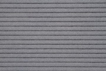 Gray textured grooved lines felt fabric material background