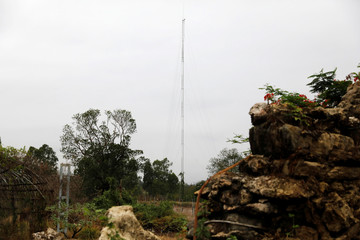 A radio tower is seen inside a raided compound belonging to Sue Songkittikul, a suspected Sam Gor syndicate operations chief, in Mae Sot