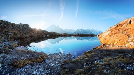 Foto auf Leinwand Blau Sun rising on Chesery lake (Lac De Cheserys) in France Alps. Monte Bianco mountain range on background. Landscape photography, Chamonix
