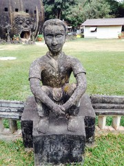 Statue of Sitting Boy at Buddha Park in Laos