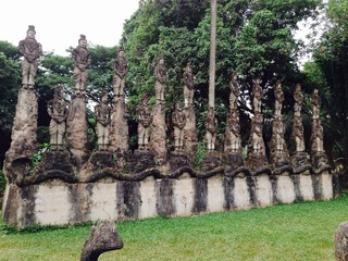Many Statues of Buddha in a Park in Laos