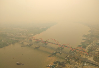 An aerial view of Palembang city covered by smoke from the forest fire in South Sumatra province