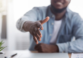 HR manager extending hand for handshake after successful job interview