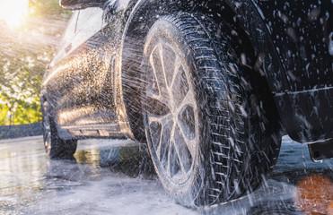 Washing SUV car with soap. Close up Car Wash concept.