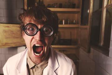 Crazy scientist in laboratory