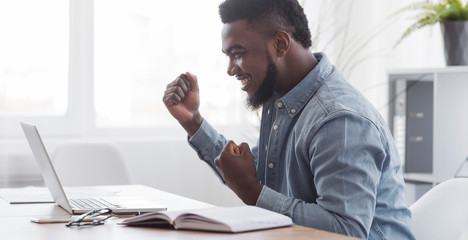 Happy African American Freelancer Celebrating Successful Online Interview