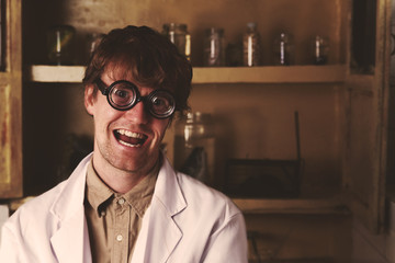 Crazy scientist laughing in laboratory