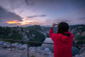 Asian women take pictures of grand canyon in Thailand