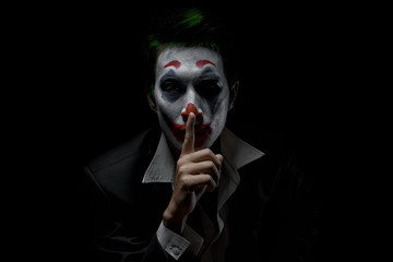 Makeup for Halloween: Image of a man in a joker makeup