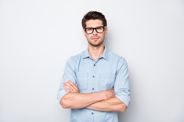 Photo of serious confident business coach standing with arms crossed with bristle on his face staring at you isolated over grey color background