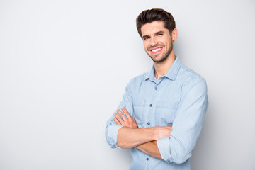 Turned photo of positive cheerful man feel content want be true leader in his enterprise wear denim jeans clothes isolated over grey color background Wall mural