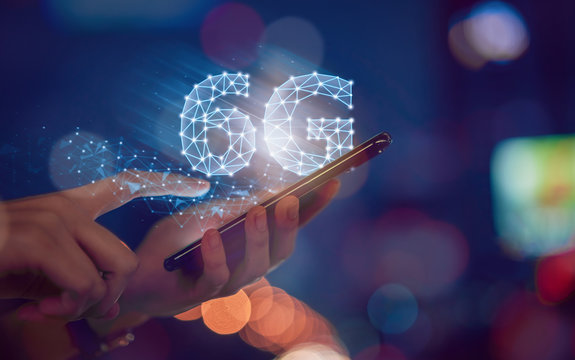 Concept of future technology 6G network, hands press smartphone and high-speed new generation networks screen interface. Wireless systems and internet of things (IOT).