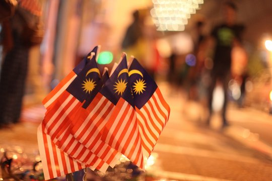 Selective focused shot of small Malaysian flags next to each other. Perfect for depicting Malaysia