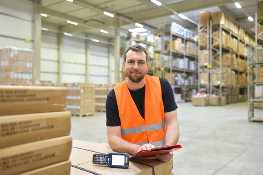 warehouse worker in a forwarding agency - interior with forklift - transport and storage of goods