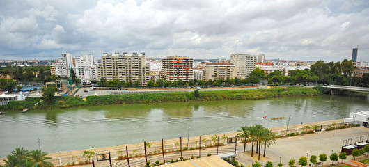 Skyline of modern Los Remedios neighborhood and Guadalquivir river in Seville, Andalusia, Spain