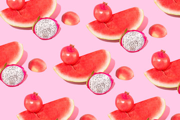 Watermelon, Peach, Dragonfruit and Pomegranate Fruit On Pink Background, Isolated Studio Shot