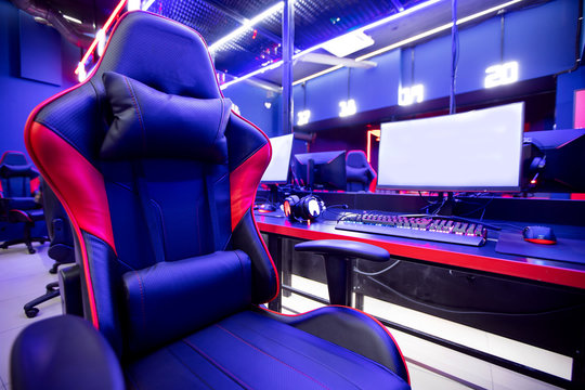 Professional gamers cafe room with powerful personal computer game chair blue color. Concept cyber sport arena