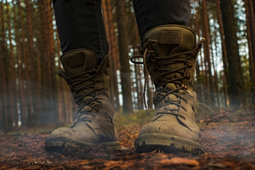 hiking boots on a wooden background