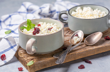 Cottage cheese with dried cranberries in a ceramic bowl.