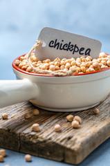 Organic chickpeas in a ceramic bowl.