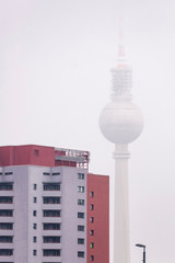 The famous Berlin TV Tower almost completely covered by fog on a winter morning, Berlin, Germany