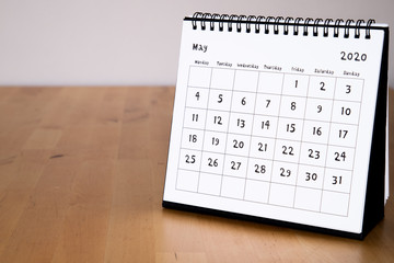 Month page: May in 2020 paper calendar with funny font on the wooden table