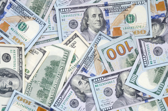 Top view of one hundred dollar banknotes made background. USD currency concept and rich life