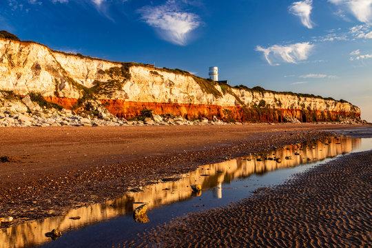 Light house reflection on the cliffs of Hunstanton Norfolk east Anglia England