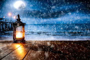 Snowy winter night landscape with wooden board top for products and decorations.