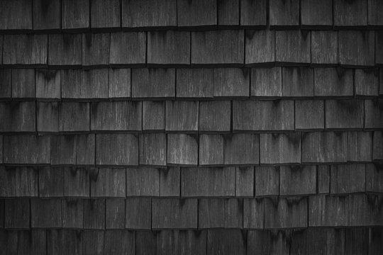 Close up of black wood roof shingles