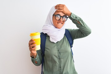 Printed kitchen splashbacks Fairytale World Young Arab student woman wearing hijab and drinking coffee over isolated background stressed with hand on head, shocked with shame and surprise face, angry and frustrated. Fear and upset for mistake.