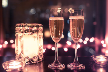 Wall Mural - Champagne drinks in a romantic candle light setting.