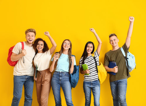 Group of happy students on color background