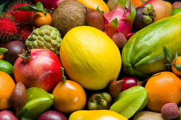 Tropical fruits, different ripe whole exotic fruits from Thailand, healthy food background, diet and vegetarian nutrition, selective focus Wall mural