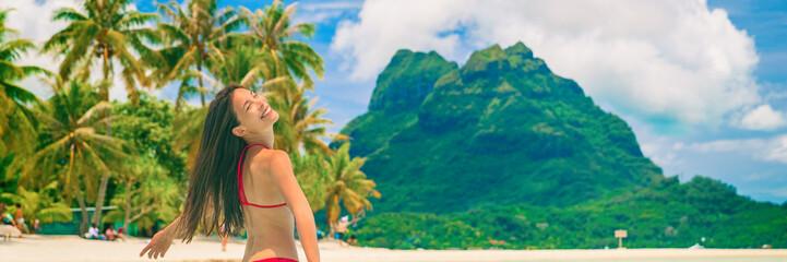 Wall Mural - Luxury travel holiday banner panoramic vacation beach destination in Tahiti. Happy Asian tourist woman on Bora bora panorama background.