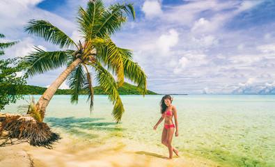 Wall Mural - Luxury beach vacation Tahiti Bora Bora bikini woman swimming in paradise getaway destination. Beautiful Asian swimsuit model relaxing .