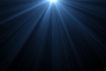 Blue rays light on back background.
