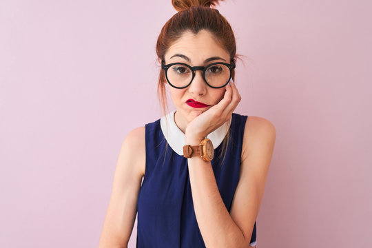 Redhead woman with pigtail wearing elegant dress and glasses over isolated pink background thinking looking tired and bored with depression problems with crossed arms.